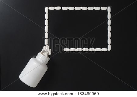 Medical presentation background with a lot a free empty copy space for your text. Pills spilling out from bottle and forming a rectangle. Innovative and different wallpaper for medical infographic.