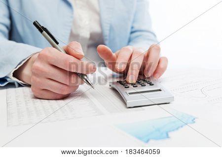 Financial accounting. Business woman using calculator