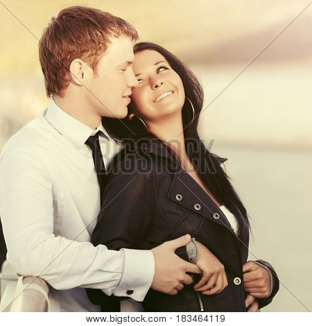 Happy young couple in love. Stylish fashion model outdoor