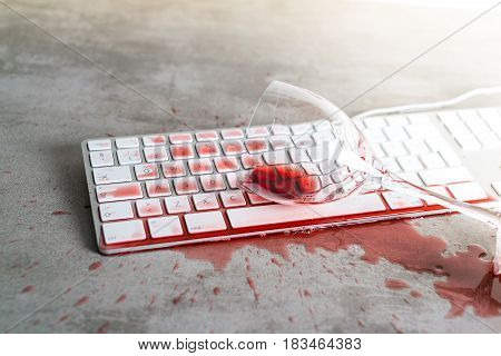 Red Wine Spilled Over Computer Keyboard On Concrete Table