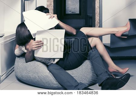 Young business couple flirting in office. Stylish male and female model indoors