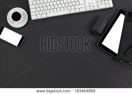 Keyboard, coffee cup, smartphone, digital tablet and mouse on grey background
