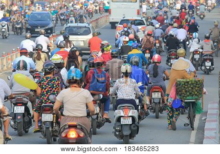 HO CHI MINH CITY VIETNAM - DECEMBER 1, 2016: Unidentified people commute in downtown Ho Chi Minh City.