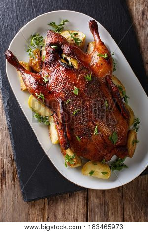 Beautiful Food: Baked Whole Duck With Apples Close-up On A Platter. Vertical Top View