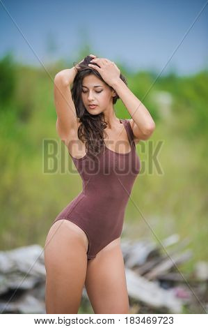 pretty slim girl with brown hair in a brown body