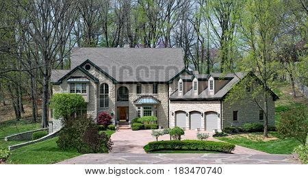 Beautiful Stone Home in Woods in Springtime