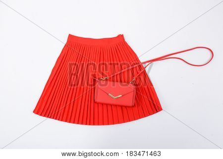 Red pleated skirt with bag isolated
