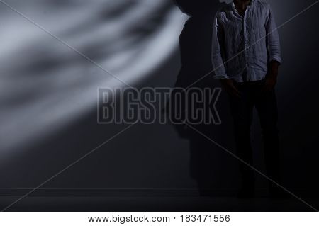 Man Leaning Against Wall