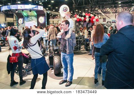 St. Petersburg Russia - 15 April, Family photo at motor show,15 April, 2017. International Motor Show IMIS-2017 in Expoforurum. Visitors and participants of the annual moto-salon in St. Petersburg.