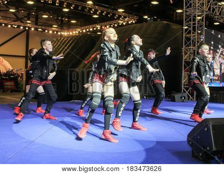 St. Petersburg Russia - 15 April, Dancing group of teenagers on stage,15 April, 2017. International Motor Show IMIS-2017 in Expoforurum. Dance show group of teenagers in the style of hip-hop.