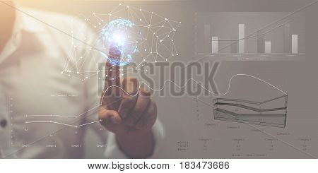 Visual effects. Future technology touch screen interface. Handsome African American businessman in shirt touching screen interface, drawing a chart in futuristic office.