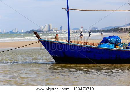 Hua Hin Thailand - April 7 2017 : Wooden fishing boat on a sandy beach