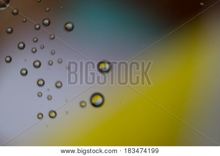 Beautiful drops colorful bokeh blurred defocused dots soft lights background with selective focus.
