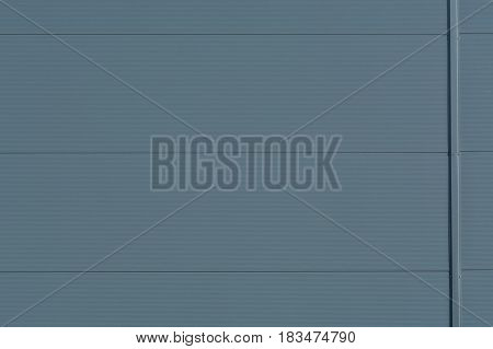 Silver-colored metal wall corrugated sheet metal background.