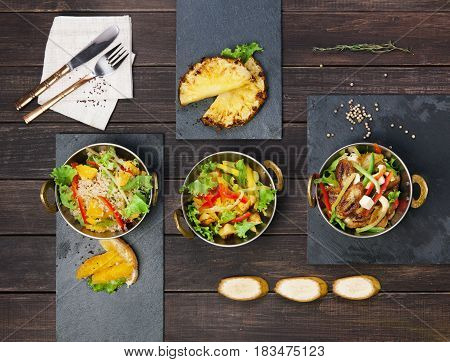 Vegan healthy food. Indian restaurant, vegetable salads in copper bowl served on wooden table, top view