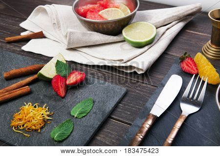 Healthy restaurant food. Closeup of table served with vegetarian meal, fruits and utensil, selective focus