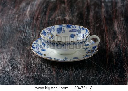 Vintage Teacup And Saucer, Close Up On A Dark Wooden Background