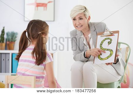 Speech Pathologist With Young Girl