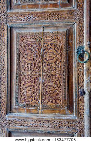 Old wooden carved door Samarkand Registan Uzbekistan