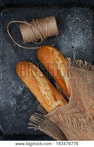 Tasty  homemade baguette bread on dark background