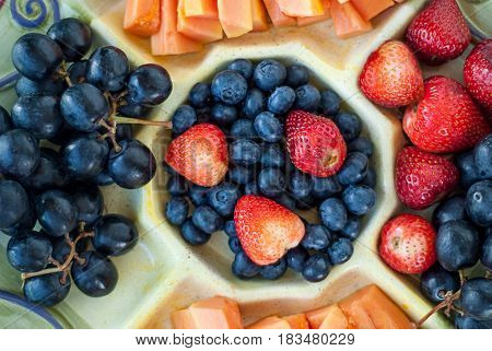 Fruit plate of Grape, strawberry, blueberry and melon