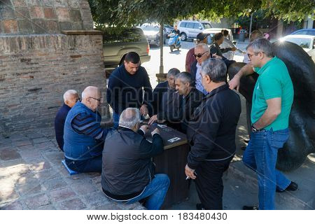 Tbilisi, Georgia-SEPTEMBER 25, 2016: Georgian men playing cards for money in Tbilisi city centre, Georgia. September.