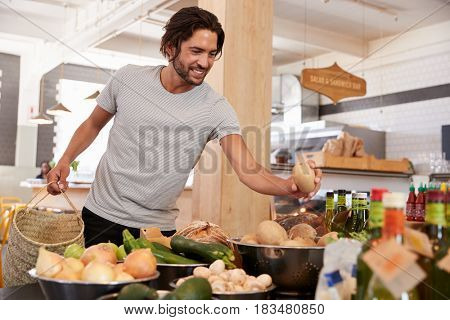 Man Shopping For Organic Produce In Delicatessen