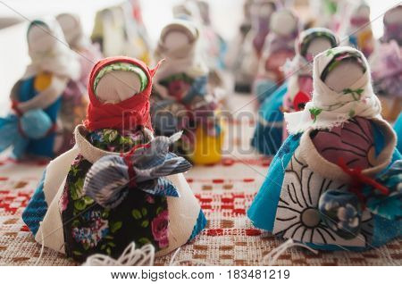 Rag dolls Russian crafts and authentic Souvenirs with their hands