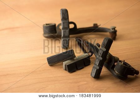 Worn out bicycle brake pads on work table.