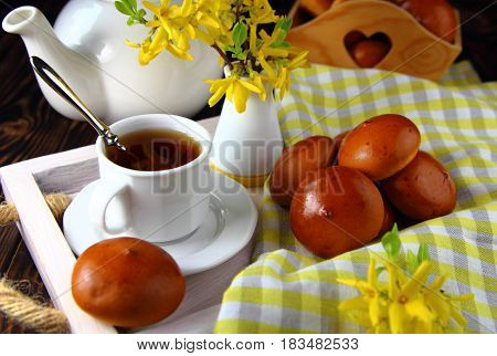 Breakfast   in bed with fresh buns and yellow flowers
