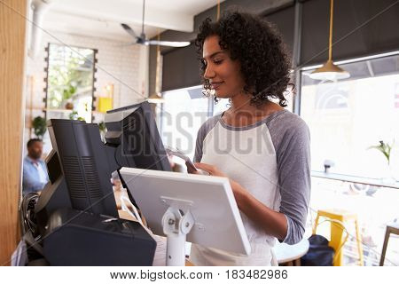 Waitress At Cash Register In Coffee Shop