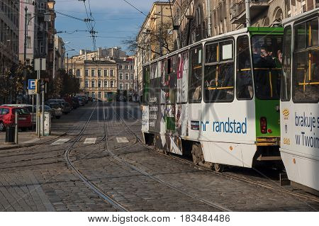 POZNAN, GREATER POLAND / POLAND - NOVEMBER, 2014: Tram public transport on the streets of a big city