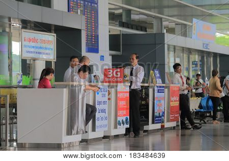 HO CHI MINH CITY VIETNAM - DECEMBER 2, 2016: Unidentified people work at travel service desk Ho chi Minh City International airport.