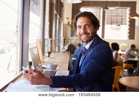 Portrait Of Businessman With Phone Working In Coffee Shop