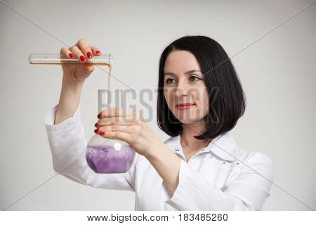 the beautiful woman the doctor with beakers on a white background