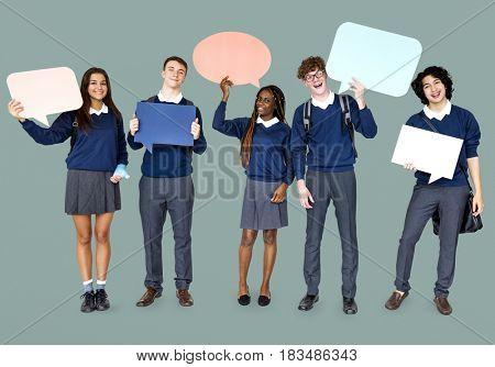 Group of Diverse Students Showing Speech Bubbles Studio Portrait