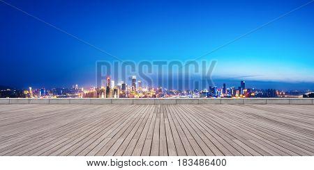 landmark buildings in chongqing from empty wooden floor