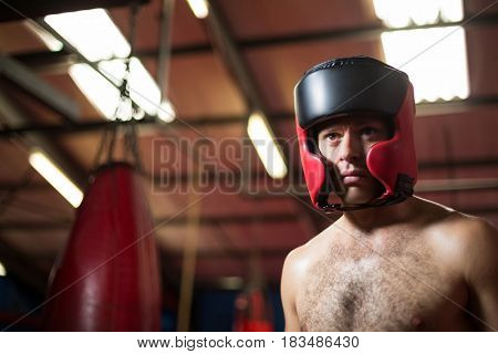 Boxer wearing headgear in fitness studio