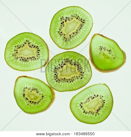 Healthy food. Tropical fruit. Whole and sliced kiwi. Kiwi fruit. Still life. Juicy kiwi on the wooden table