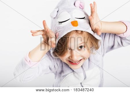 Funny Little Girl In Pajamas Jumping And Having Fun In Bed At Home. Pajama Party, Day Off, Holiday,
