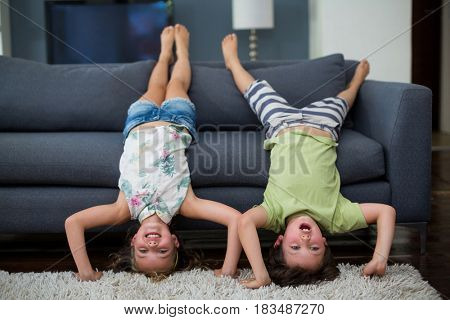 Playful siblings having fun in living room at home