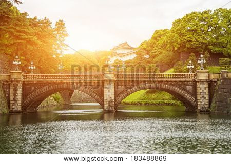 tokyo,japan-May 17,2016:old stone bridge near japanese imperial palace with sunbeam