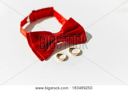 Men's accessories - bow tie wedding rings on white background