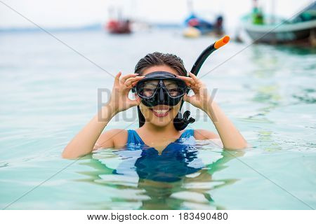 Pretty asian woman wearing underwater snorkling glasses