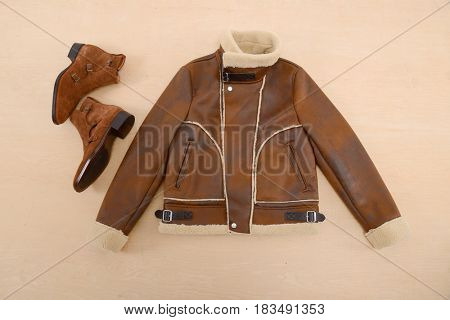 Jacket clothes with shoes –wooden background
