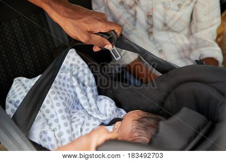 Close Up Of Parents Bringing Newborn Baby Home In Car
