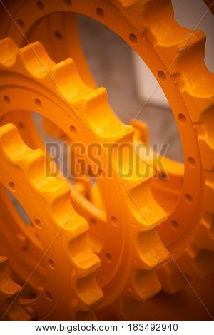 Close up image of some big yellow sprockets.