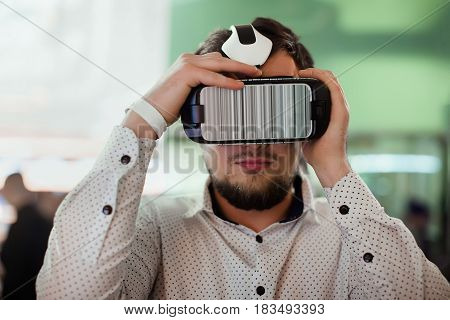 Man wearing virtual reality glasses in interer