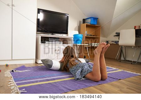 Rear View Of Girl Watching Television In Playroom