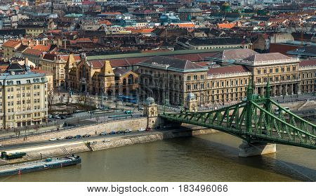 Square near Great Market Hall and Liberty Bridge over Danube river by day in Budapest, Hungary. Cityscape of Pest side view from Gellert Hill